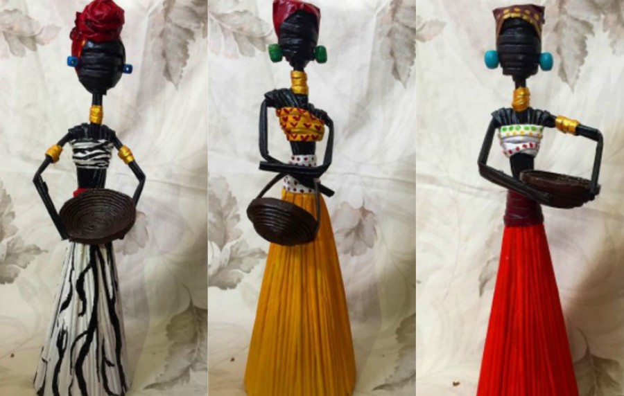 Familia hondureña crea muñecas africanas con papel periódico